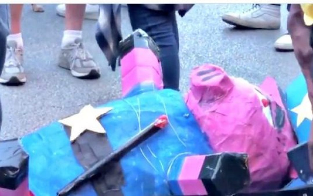 BLM Dance Around Severed Heads of Piñata Pigs Symbolizing The Police (Videos)